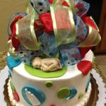 Butter cream cake with Fondant accents.  Fondant baby and fabric bow. 6 inch round cake serves 12