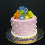 Buttercream frosting with gum paste flowers. 6 inch round cake serves 12