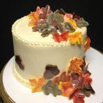 60inch round buttercream cake with fondant leaves. Serves 12