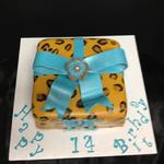 9 inch square covered in fondant hand painted leopard spots. Fondant bow and accents. serves 30