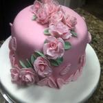 8 inch fondant covered cake.  Gum past roses. serves 24
